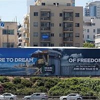A picture taken on May 13, 2019, shows an anti-occupation billboard, by Israeli NGO Breaking The Silence, erected on a street in the Israeli coastal city of Tel Aviv. (Photo by JACK GUEZ / AFP)