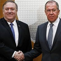 Russian Foreign Minister Sergey Lavrov (R) shakes hands with US Secretary of State Mike Pompeo during a meeting in Sochi, Russia, on May 14, 2019. (Pavel Golovkin/Pool/AFP)