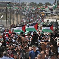 "Palestinian demonstrators gather east of Gaza City in the Gaza Strip on May 15, 2019, during a protest marking 71st anniversary of the ""Nakba,"" or ""Catastrophe,"" in 1948. (Mahmud Hams/AFP)"