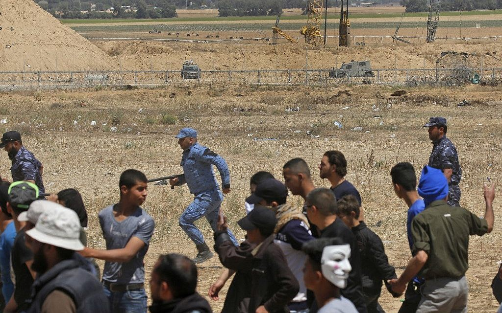 Palestinian Hamas police block protesters from reaching the border fence east of Khan Yunis in the southern Gaza Strip on May 15, 2019. (Photo by Said KHATIB / AFP)