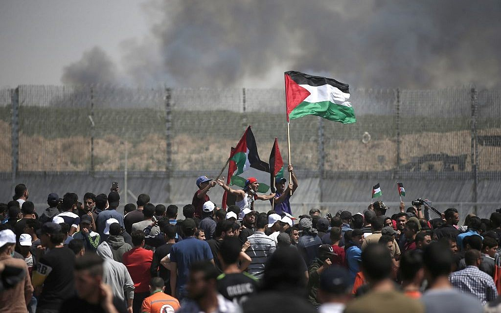 Palestinian demonstrators gather near the border fence east of Gaza City in the Gaza Strip on May 15, 2019, during a Nakba protest. (MAHMUD HAMS / AFP)