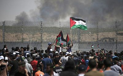 Palestinian demonstrators gather near the border fence east of Gaza City in the Gaza Strip on May 15, 2019, during a Nakba Day protest. (Mahmud Hams/AFP)