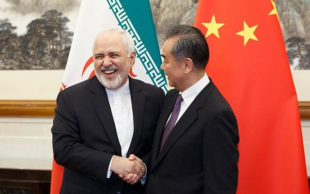 China's Foreign Minister Wang Yi (R) meets Iran's Foreign Minister Mohammad Javad Zarif at the Diaoyutai State Guesthouse in Beijing on May 17, 2019. (Thomas Peter/pool/AFP)