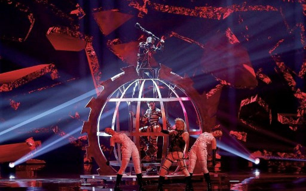 "Iceland's Hatari perform the song ""Hatrid mun sigra"" during the Grand Final of the 64th edition of the Eurovision Song Contest 2019 at Expo Tel Aviv on May 18, 2019. ( Jack GUEZ / AFP)"