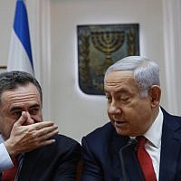 Prime Minister Benjamin Netanyahu (R) listens to Minister of Transportation Yisrael Katz during the weekly cabinet meeting at the Prime Minister's office in Jerusalem on May 19, 2019. (Ariel Schalit / various sources / AFP)