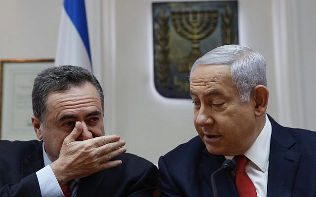 Prime Minister Benjamin Netanyahu (R) listens to then-transportation minister Yisrael Katz during a weekly cabinet meeting at the Prime Minister's Office in Jerusalem, on May 19, 2019. (Ariel Schalit / various sources / AFP)