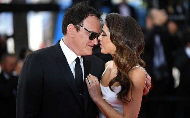 """US film director Quentin Tarantino (L) and his wife Israeli singer Daniella Pick arrive for the screening of the film """"Once Upon a Time... in Hollywood"""" at the 72nd edition of the Cannes Film Festival in France, on May 21, 2019. (LOIC VENANCE / AFP)"""