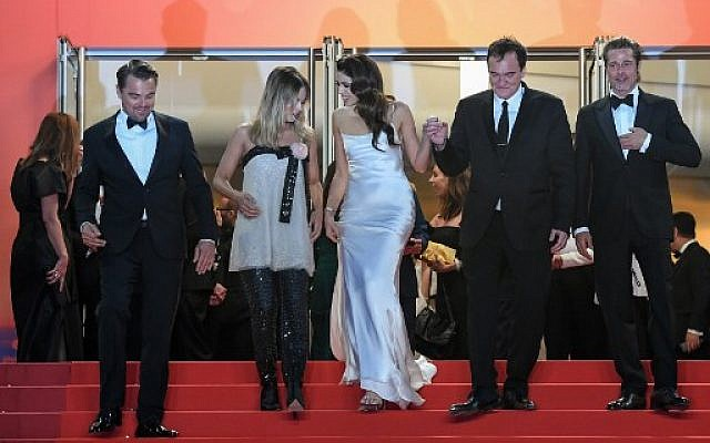 "US actor Leonardo DiCaprio (L), Australian actress Margot Robbie, US film director Quentin Tarantino (2ndR) and his wife Israeli singer Daniella Pick and US actor Brad Pitt on the red carpet at the Festival Palace after the screening of the film ""Once Upon a Time... in Hollywood"" at the Cannes Film Festival in France, May 21, 2019. (LOIC VENANCE / AFP)"