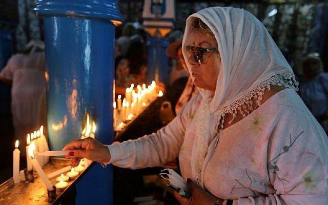 A Jewish pilgrim lights a candle on the first day of the annual Jewish pilgrimage to the El Ghriba Synagogue, Africa's oldest, on Tunisia's Mediterranean resort island of Djerba on May 22, 2019. (Fathi Nasri/AFP)