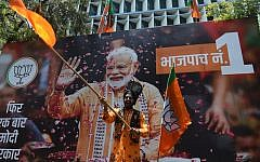 An Indian supporter of Indian Prime Minister Narendra Modi's Bharatiya Janata Party (BJP) celebrates the election results outside the BJP headquarters in Mumbai on May 23, 2019.  (Punit Paranjpe/AFP)