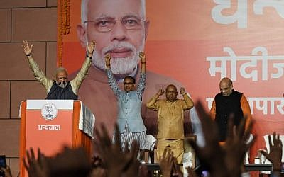 India Prime Minister Narendra Modi (L) gestures on stage during his victory speech at the Bharatiya Janta Party (BJP) headquaters after winning India's general election, in New Delhi on May 23, 2019. (Photo by PRAKASH SINGH / AFP)