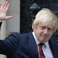 In this file photo from July 13, 2016, Boris Johnson waves as he leaves 10 Downing Street in London. (Oli Scarff/AFP)