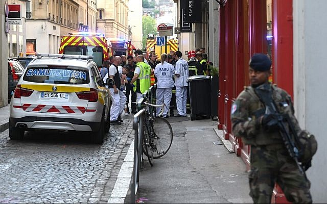 French security and emergency services block the area following a suspected package bomb exploded along a pedestrian street in the heart of Lyon, southeast France, on May 24, 2019. (Philippe Desmazes/AFP)