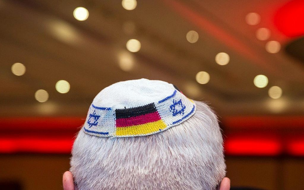 Illustrative - file picture from June 10, 2014 in Frankfurt am Main, Germany, shows a man wearing a kippa with the flags of Germany and Israel. (Frank Rumpenhorst / dpa / AFP)