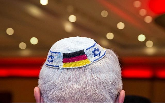 Illustrative - file picture from June 10, 2014 in Frankfurt am Main, Germany, shows a man wearing a kippah with the flags of Germany and Israel. (Frank Rumpenhorst / dpa / AFP)
