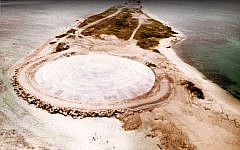 Picture taken by the US Defense Nuclear Agency in 1980, shows the huge dome built over top of a crater left by one of the 43 nuclear nuclear tests over Runit Island in Enewetak in the Marshall Islands. (GIFF JOHNSON / US DEFENCE NUCLEAR AGENCY / AFP)