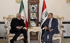 Iraqi Foreign Minister Mohammad Ali al-Hakim, right, meets Iran's Foreign Minister Mohammad Javad Zarif in Baghdad, on May 26, 2019. (SABAH ARAR/AFP)
