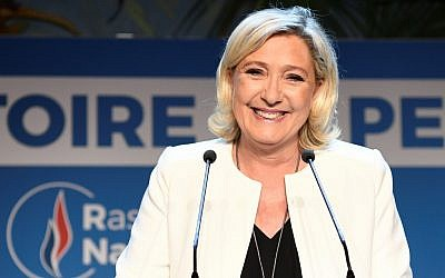 French far-right Rassemblement National (RN) President and member of Parliament Marine Le Pen delivers a speech after the announcement of initial results during an RN election-night event for European parliamentary elections on May 26, 2019, at La Palmeraie venue in Paris. (Bertrand GUAY / AFP)