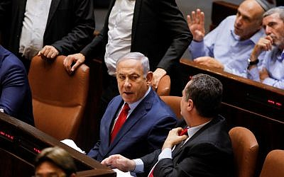 Prime Minister Benjamin Netanyahu sits before a vote on a bill to dissolve the Knesset on May 29, 2019, at the Knesset in Jerusalem. (Menahem Kahana/AFP)