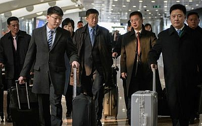 This file photo taken on February 19, 2019 shows a man believed to be North Korean negotiator Kim Hyok Chol (center L-blue tie) after arriving on an Air Koryo flight from Pyongyang, at Beijing international airport. (Ed JONES / AFP)