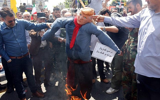 Iranians burn an effigy of US President Donald Trump during a parade marking al-Quds (Jerusalem) International Day in Tehran on May 31, 2019. (AFP)