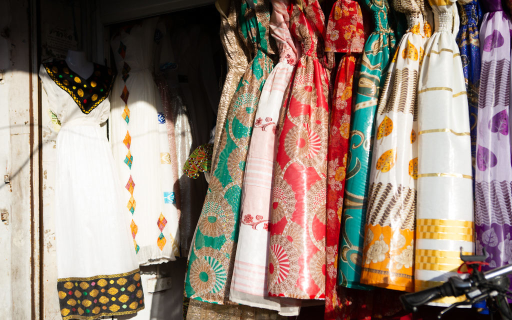Colorful dresses for sale at an Eritrean bridal salon in south Tel Aviv. (Dafna Talmon)