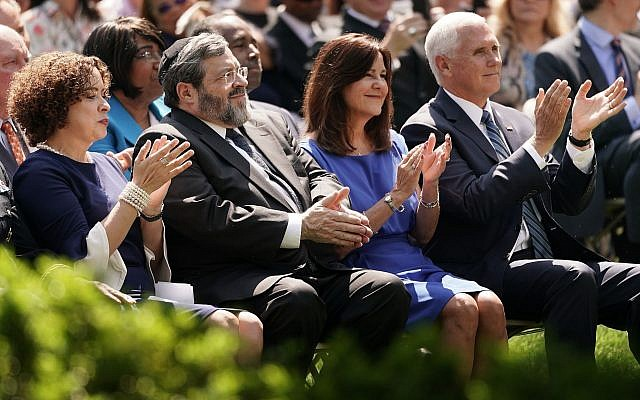 From left, Pastor Marilyn Rivera, Rabbi Abba Cohen, Karen Pence and Vice President Mike Pence participate in a National Day of Prayer service in the Rose Garden at the White House, May 2, 2019. (Chip Somodevilla/Getty Images/via JTA)
