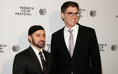 Khalid Latif, executive director of the Islamic Center at NYU, left, and Rabbi Yehuda Sarna, executive director of the university's Bronfman Center for Jewish Student Life, attend the Tribeca Film Festival in New York City, April 17, 2014. (Emal Countess/Getty Images for the 2014 Tribeca Film Festival via JTA)