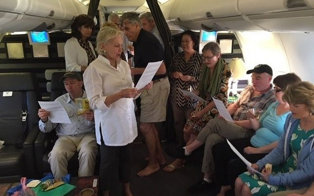 Jill Cooper Udall leads a seder aboard a US military aircraft 30,000 feet over Vietnam, April 19, 2019. (Courtesy of Cooper Udall)