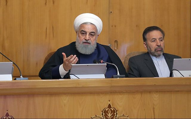 President Hassan Rouhani (left) at a meeting of the Iranian cabinet, May 29, 2019. (Iran President official website)