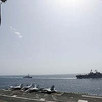 American navy ships USS Kearsarge  and USS Bainbridge deployed alongside the aircraft carrier USS Abraham Lincoln in the Gulf waters near Iran, May 17, 2019 (MCSN Michael S. Singley, US Navy)