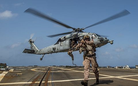 """US Marines training on the flight deck of the guided-missile destroyer USS Bainbridge, May 18, 2019, deployed in the Gulf of Arabia """"to respond to contingencies and to defend US forces and interests in the region."""" (MCS Jason Waite/US Navy)"""