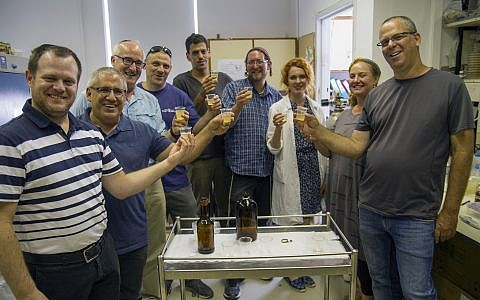 Tasting the biblical-style beer produced from ancient yeast strains dormant for thousands of years. (Yaniv Berman/ Courtesy of the Israel Antiquities Authority)