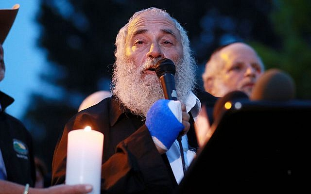 Rabbi Yisroel Goldstein speaks to community members and congregants about the shooting at the Chabad of Poway Synagogue during a candlelight vigil for the victim of the attack at Valle Verde Park in Poway, April 28, 2019. (Sandy Huffaker/AFP/Getty Images via JTA)