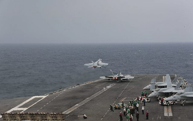 Two F/A-18E Super Hornets launch from the flight deck of the Nimitz-class aircraft carrier USS Abraham Lincoln in the Mediterranean Sea, April 25, 2019.  (US Navy/Matt Herbst)
