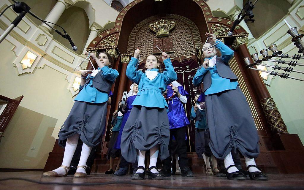 Children play musical instruments during the celebration of Hanukkah at the Kharkiv Choral Synagogue, in Kharkiv, northeastern Ukraine, December 5, 2018. (Vyacheslav Madiyevskyy/Barcroft Media via Getty Images)