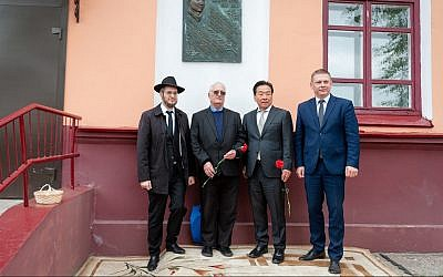 Nobuki Sugihara, second from right, with Chaim Chesler, in blue shirt, and guests of Limmud FSU Minsk at the village of Mir, Belarus, during an unveiling of a plaque for Chiune Sugihara, May 2, 2019. (Boris Brumin/via JTA)