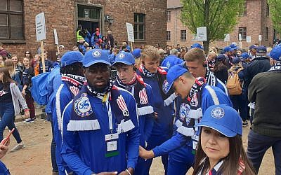 Players from the under-18 division of Britain's Chelsea soccer club attend a March of the Living event in the former Auschwitz Nazi camp in Poland, May 2, 2019. (Cnaan Liphshiz/JTA)