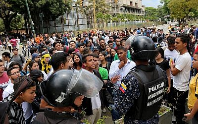 Students argue with police officers during a rally in support of opposition leader Juan Guaido and against Nicolas Maduro at Universidad Central de Venezuela in Caracas, Venezuela, May 2, 2019. (Edilzon Gamez/Getty Images/via JTA)