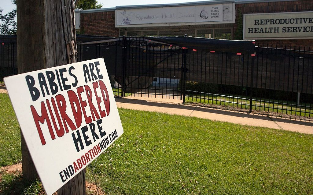 An anti-abortion sign is placed outside of the Reproductive Health Services building in Montgomery, Alabama, on May 20, 2019.  (Seth HERALD / AFP/Getty Images)