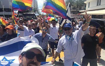 Israeli Consul General of Miami Lior Hayat (in blue baseball cap) at the 2019 Miami Gay Pride Parade. (Facebook)