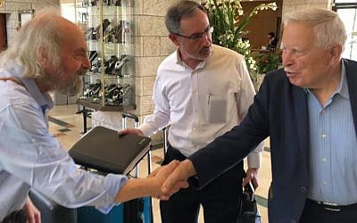 Paul Jospa, son of Hertz and Yvonne Jospa, meets Shaul Harel (right) for the first time as B'nai B'rith World Center Director Alan Schneider looks on, Jerusalem, May 1, 2019. (Renee Ghert-Zand/TOI)