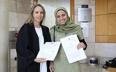 Arab Israeli poet Dareen Tatour (right) and lawyer Gabi Lasky at the Nazareth District Court, May 16, 2019. (Facebook)