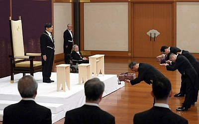Japan's new Emperor Naruhito receives the Imperial regalia of sword and jewel as proof of succession at the ceremony at Imperial Palace in Tokyo, Wednesday, May 1, 2019. (Japan Pool via AP)