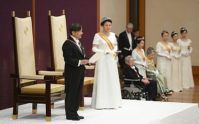 Japan's new Emperor Naruhito, accompanied by new Empress Masako, makes his first address during a ritual after succeeding his father Akihito at Imperial Palace in Tokyo, May 1, 2019. (Japan Pool via AP)