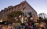 A menorah and flowers are seen outside the Tree of Life Synagogue in preparation for a celebration service on the first night of Hanukkah, in the Squirrel Hill neighborhood of Pittsburgh, December 2, 2018. (AP Photo/Gene J. Puskar)