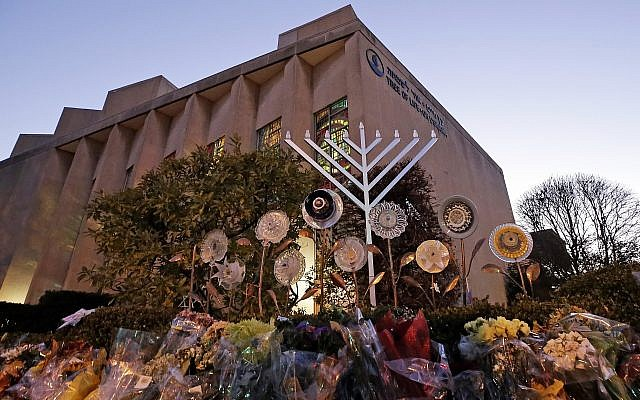 File: A menorah and flowers are seen outside the Tree of Life Synagogue in preparation for a celebration service on the first night of Hanukkah, in the Squirrel Hill neighborhood of Pittsburgh, December 2, 2018. (AP Photo/Gene J. Puskar)