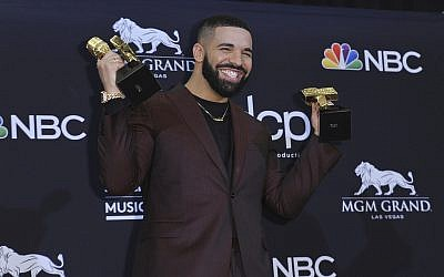 Drake poses with his awards at the Billboard Music Awards on May 1, 2019, at the MGM Grand Garden Arena in Las Vegas. (Richard Shotwell/Invision/AP)