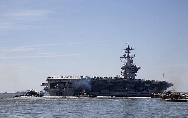 In this April 1, 2019, file photo, the USS Abraham Lincoln deploys from Naval Station Norfolk, in the vicinity of Norfolk, Va. The White House said Sunday, May 5, that the U.S. is deploying military resources to send a message to Iran. White House national security adviser John Bolton said in a statement that the U.S. is deploying the USS Abraham Lincoln Carrier Strike Group and a bomber task force to the U.S. Central Command region, an area that includes the Middle East. (Kaitlin McKeown/The Virginian-Pilot via AP)
