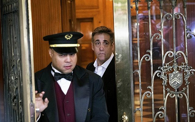 Michael Cohen, former attorney to President Donald Trump, leaves his apartment building before beginning his prison term, on May 6, 2019, in New York. (AP Photo/Kevin Hagen)